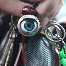 Load image into Gallery viewer, blinking doll eye keychain shown on steering wheel