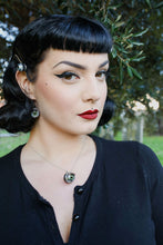 Load image into Gallery viewer, pin up model with classic makeup wears matching green doll eye necklace and earrings