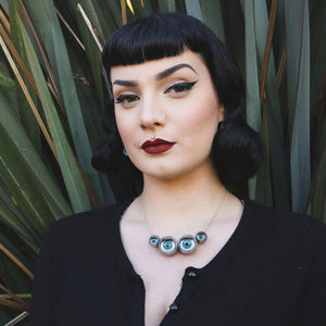 spider necklace being worn by alt/ pin up/ goth model