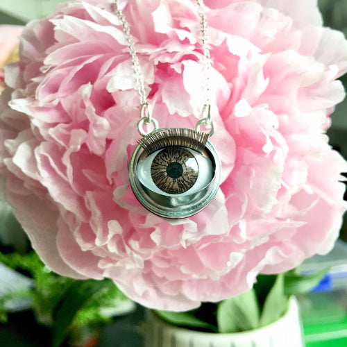 doll eye necklace brown blinking eyeball
