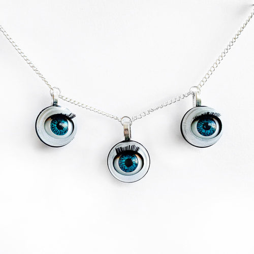 triple eye necklace by jawline jewellery 3 blinking blue doll eyes necklace creepy cute doll parts witchy macabre alternative gothic pastel goth steampunk necklace