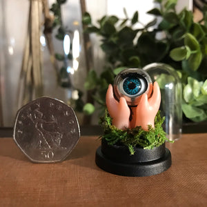 doll eyeball artwork. unsual creepy minature dome memento mori
