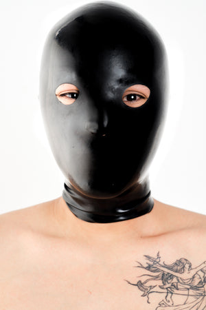 A person wearing a black latex anatomical latex mask.