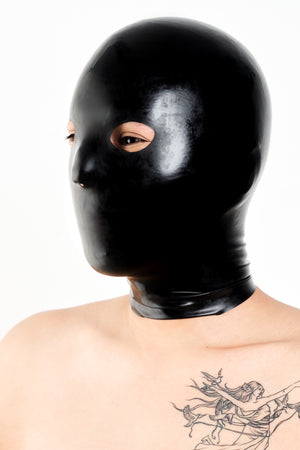 A person wearing a black anatomical latex mask.