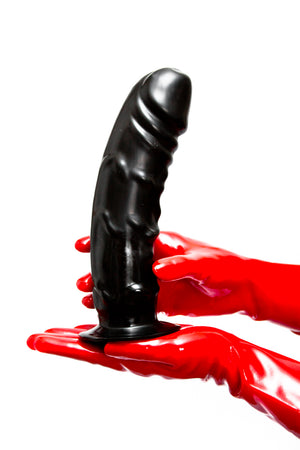 Red latex gloves holding a large penis dildo.