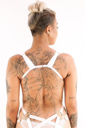 The back of a woman in a Charlie harness.
