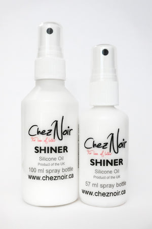 Two bottles of latex shiner, for making your latex shiny.