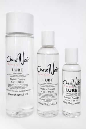 Three bottles of lubricant for getting dressed in latex.