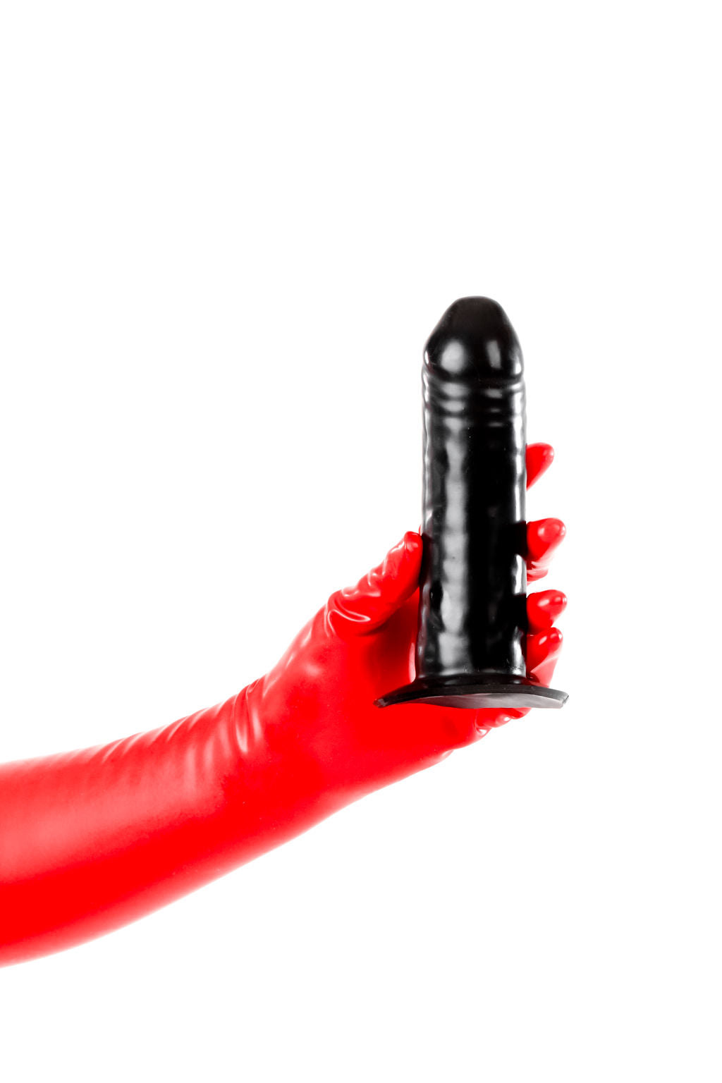 Red latex gloves holding a large solid penis dildo.