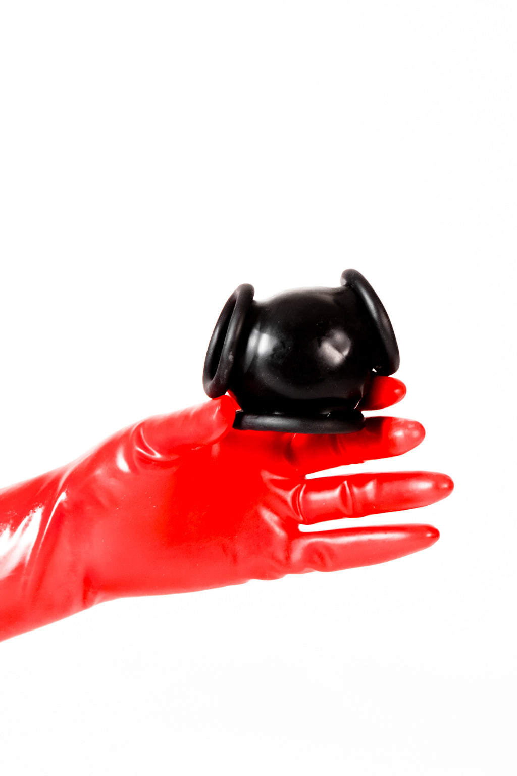 Red latex gloves holding a latex ball bag.