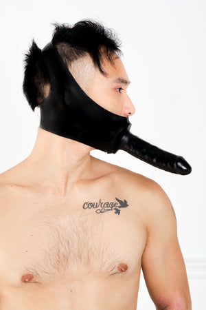 A man wearing a latex dildo mask.