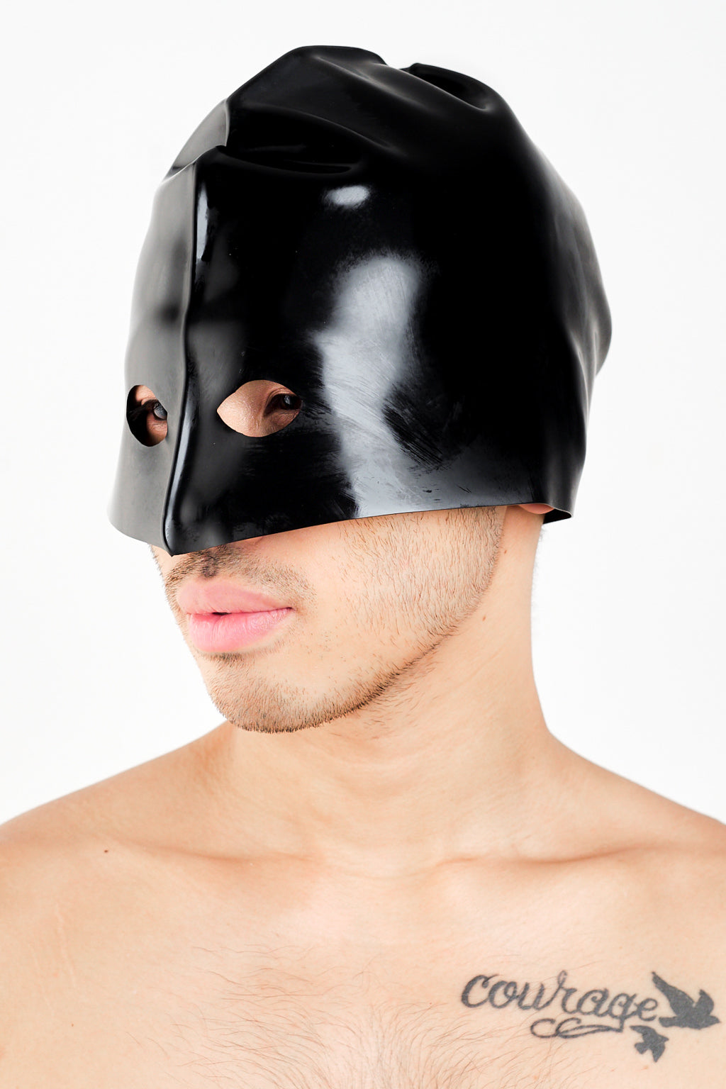 A man wearing a black latex executioners mask.