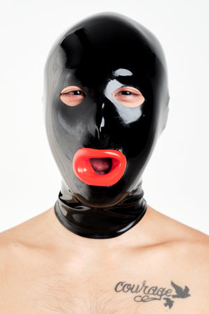 A man wearing a black latex hood with red lips.