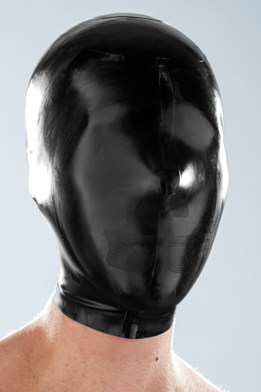 A person wearing a black micro breathe latex zentai enclosure hood.