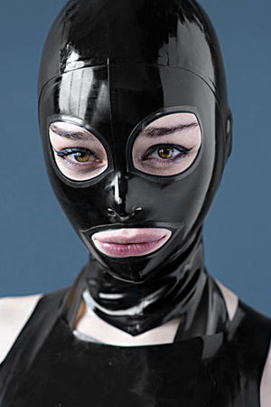 A woman wearing a black rubberdoll cat eye latex hood.