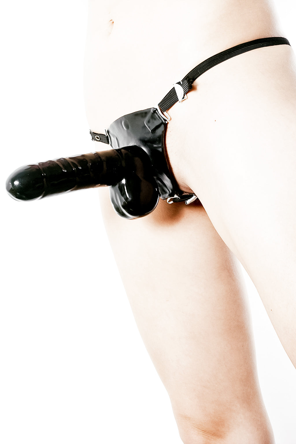 A woman wearing a strap-on dildo.