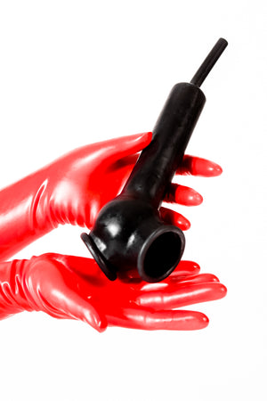 Red latex gloves holding a latex penis sheath with open ball bag and flushing tube.