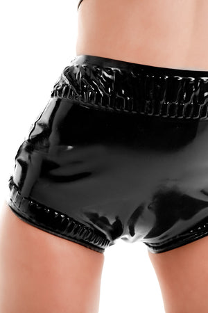 A woman wearing black frilled latex baby pants.