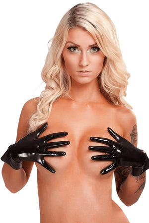 A woman wearing only black heavy weight wrist gloves.