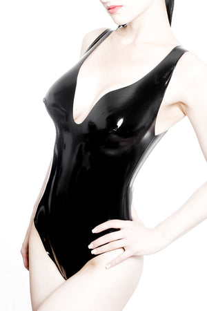 A woman wearing a black latex bodysuit.