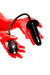 A pair of red latex gloves holding an inflatable butt plug.