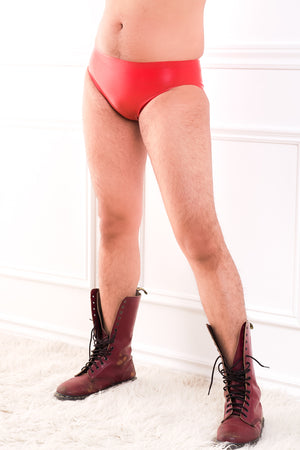 A man wearing a pair of red latex underwear.
