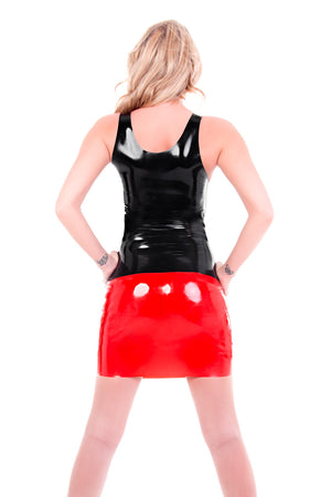The back of a woman wearing a red latex mini skirt and a black latex top.