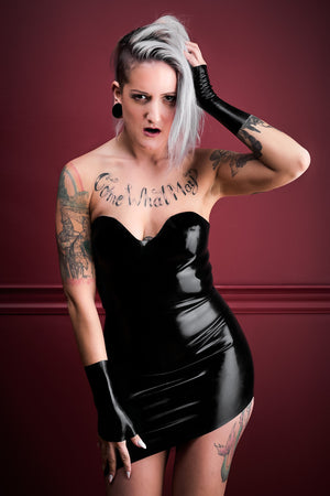 A woman wearing a black latex party dress.