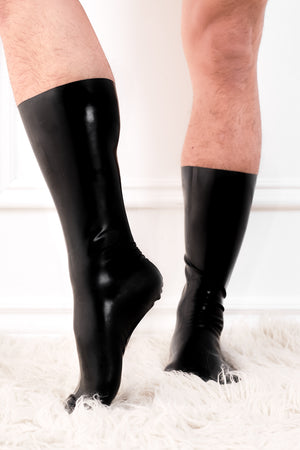 A man wearing a pair of latex socks.