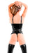 A woman wearing a black latex thong and latex stockings. A rear view, showing her ass.