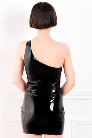 The back of a woman wearing a one shoulder latex mini dress.
