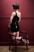 A woman kneeling on a chair wearing a one shoulder latex mini dress.