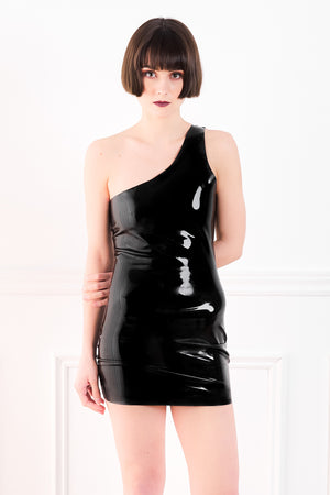 A woman wearing a one shoulder latex mini dress.