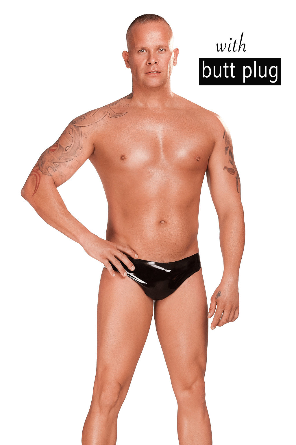 A man wearing a pair of latex briefs with a butt plug.