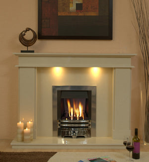 Marble Fireplace Hampton Surround with lights fitted in lounge- bespokemarblefireplaces