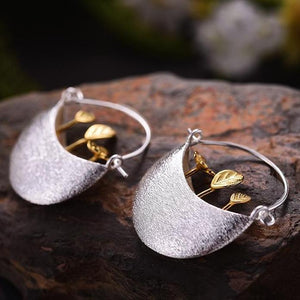 These 925 Sterling Silver Hoop Earrings with a silver planter box with gold plants coming out of them. Gardening lovers will love these.