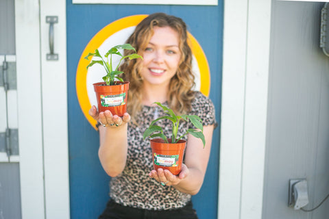 Woman holding to plants