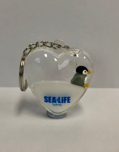 SEA LIFE Sydney Heart Shaped Keyring with Penguin in White Liquid