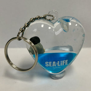 SEA LIFE Sydney Heart Shaped Keyring with Penguin in Blue Liquid