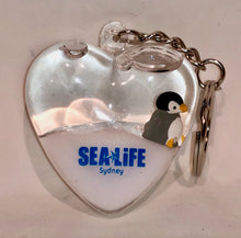 Load image into Gallery viewer, SEA LIFE Sydney Heart Shaped Keyring with Penguin in White Liquid