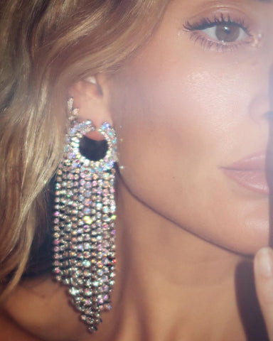 Girl wearing bold sparkly earring