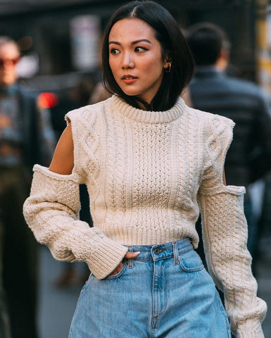 Yoyo Cao wearing a cream cut out Calvin Klein cardigan