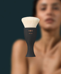 TANNING BRUSHES - Lifestyle image of model with the Big Body Tanning Brush product