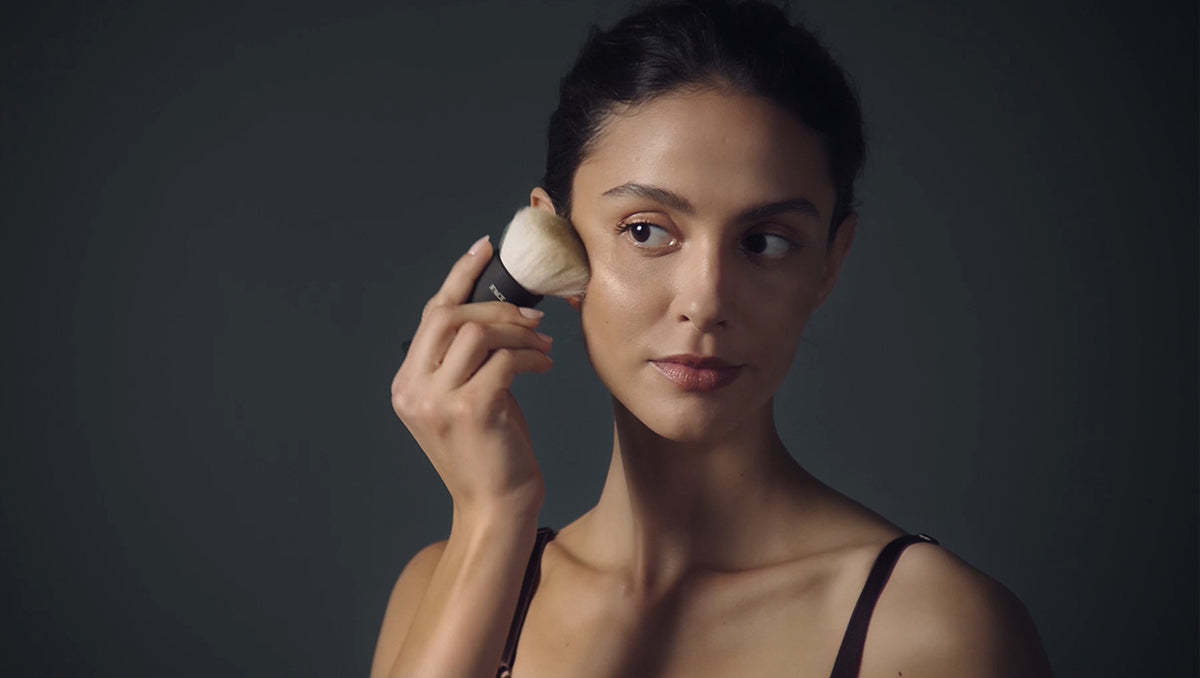 Video cover image of Natural Olive skin tone model applying tan with a Tanning Brush