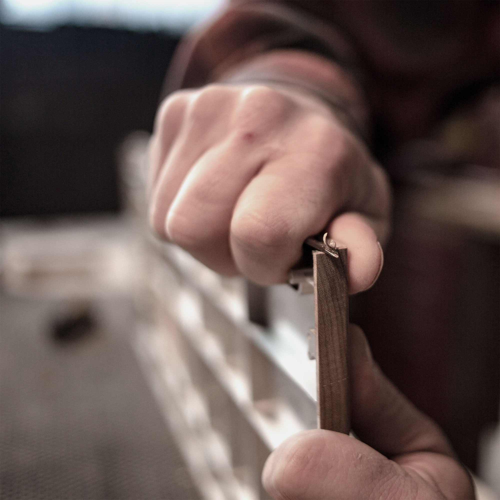 Luthier working the wood
