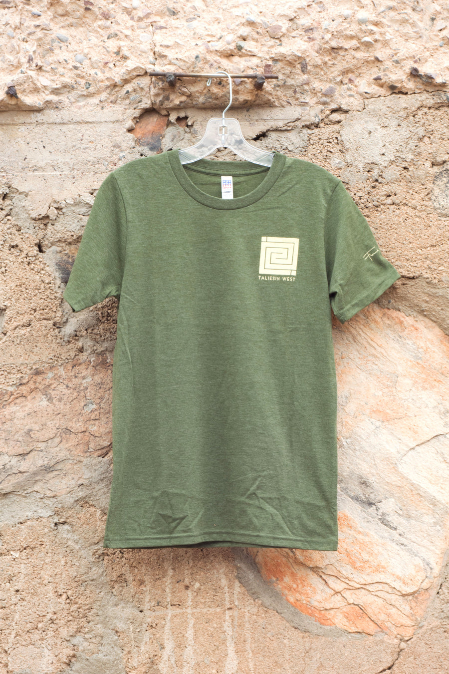 Image shows front of T-shirt with off-white Whirling Arrow on left.