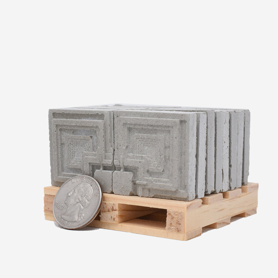 Ennis House Blocks set, showing blocks and pallet with a U.S. quarter for size comparison.