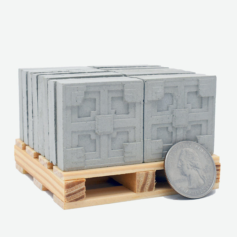 Storer House Blocks set, showing blocks and pallet with a U.S. quarter for size comparison.