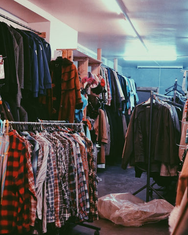 Thrift store clothes hanging up