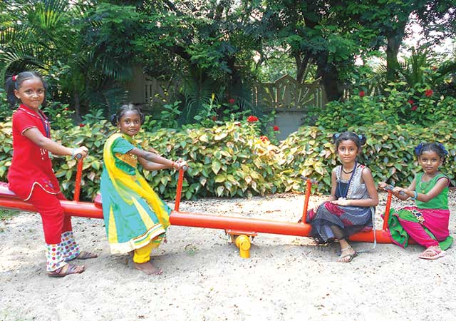 A group of children on a teeter totter Abode for Childrens India Orphanage